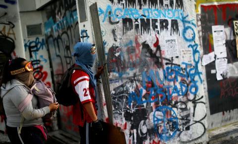 Presidente do Chile quer endurecer sanções contra encapuzados e quem cometer saques